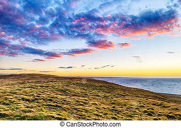 Sunset over pamaps shore in Tierra del Fuego