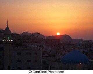 sunset over petra - sun setting over petra