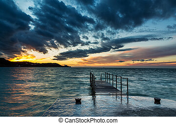 Sunset over Piran, Slovenia - Silhouette of the town Piran ...