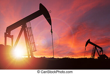 Sunset Over Pumpjack Silhouette With Copy Space
