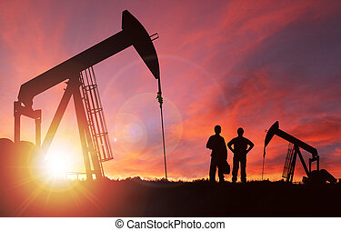 Sunset Over Pumpjack Silhouette With Copy Space - Pump jack...
