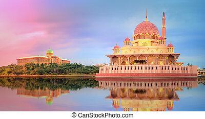 Sunset over Putrajaya Mosque and Panorama of Kuala Lumpur, Malaysia.