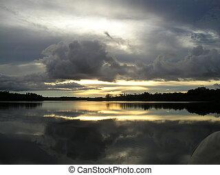 Sunset over Rio Negro in Brazil - Sunset over Rio Negro,...