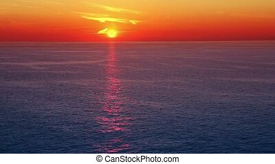 Sunset over sea from deck ship