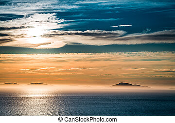 Sunset over sea in Scotland as background