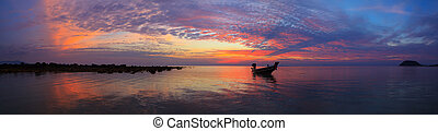 Sunset over sea with fisherman boat panorama