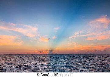 Sunset over seacoast skyline