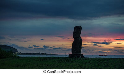 Sunset over single Moai time lapse in Easter Island - Sunset...