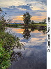 Sunset over small river in central Russia