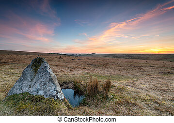 Sunset over standing stones on Bodmin Moor in Cornwall