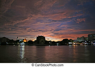 Sunset over Temple - A scenic view of the Chao Praya River...