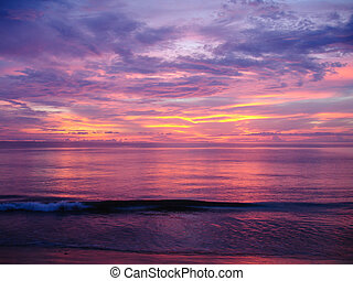 sunset over the Andaman Sea in Khao Lak, Thailand - colorful...