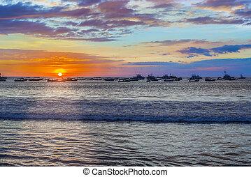 Sunset over the bay in San Juan del Sur, Nicaragua. -...