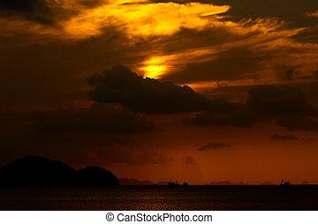 Sunset over the beach, Thailand.