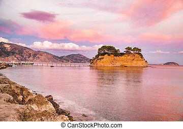 Sunset over the bridge to Agios Sostis island on Zakynthos in Greece