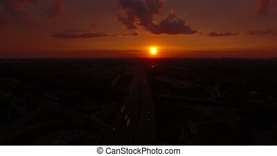 Sunset over the city aerial view