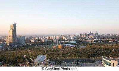 Sunset over the city of Alma-Ata. Kazakhstan. Time Lapse
