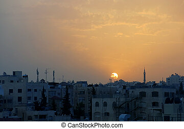 Sunset over the city of AMMAN in Jordan in the Middle East...