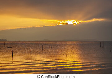 Sunset over the clam culture parks of Carril