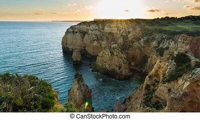 Sunset over the cliffs and beaches by Atlantic Ocean, Lagos,...