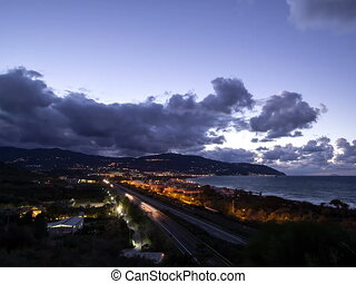 Sunset over the coast of Sicily. Patti, Italy. Time Lapse....