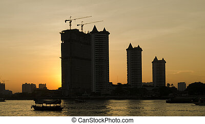 Sunset over the construction crane in river site