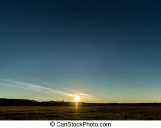 Sunset over the field with a barn. Stars appear. Time Lapse....