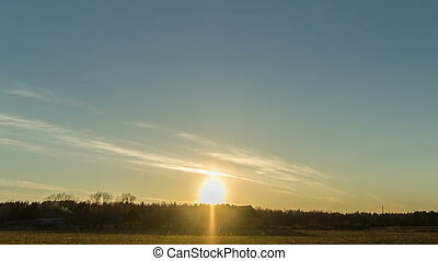 Sunset over the field with a barn. Stars appear. Time Lapse
