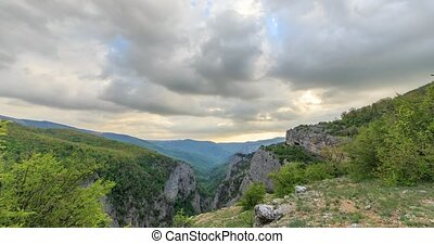 Sunset over the Grand Canyon of Crimea. Zoom. Time Lapse. Natural HDR