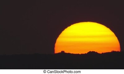 Sunset over the hills - Ultra long shot of sunset over the...