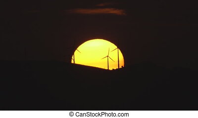 Sunset over the hills with windmills - Ultra long shot of...