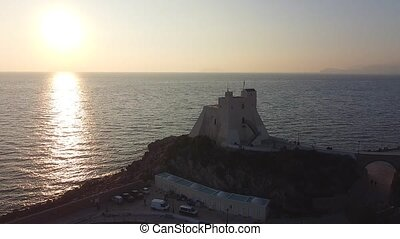 Sunset over the iconic fortress called Truglia Tower, major landmark in Sperlonga, a coastal town in the province of Latina, Italy, about halfway between Rome and Naples
