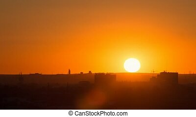 Sunset over the industrial city. Sun close-up. Karaganda, Kazakhstan. Panorama. Time Lapse