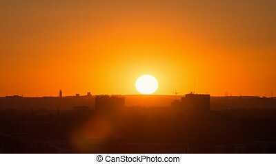 Sunset over the industrial city. Sun close-up. Karaganda, Kazakhstan. Zoom. Time Lapse