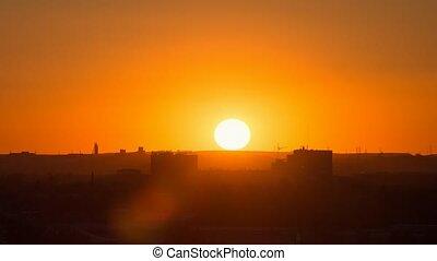 Sunset over the industrial city. Sun close-up. Karaganda, Kazakhstan. Zoom. Time Lapse
