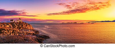 Sunset over the lighthouse in Henningsvaer on Lofoten islands