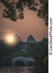 Sunset over the marble bridge on Shan Lake in Guilin