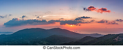 Sunset over the mountains in Thailand. Landscape panorama