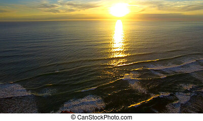 Sunset over the ocean, aerial view