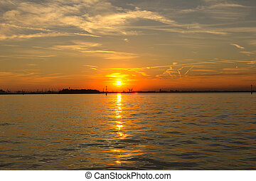 Sunset over the ocean in Venice, Italy