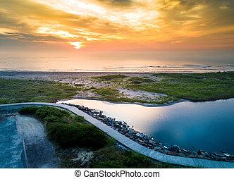 Sunset over the ocean in Wildwood, New Jersey aerial