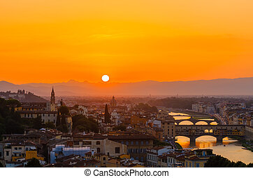 Sunset over the old town of Florence, Italy.