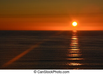 Sunset over the Pacific ocean shore