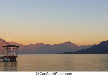 sunset over the quiet waters of Lake Iseo