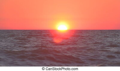 Sunset over the rippling sea
