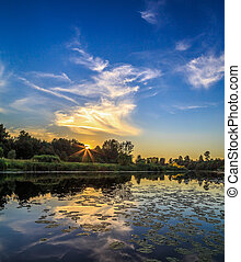 Sunset over the river, summer evening