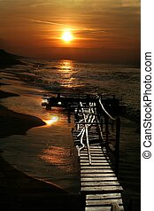 sunset over the sea and jetty