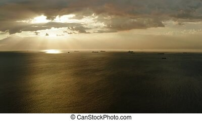 Sunset over the sea in Manila bay - Dramatic sunset over...