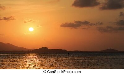 Sunset over the sea in the harbor, timelapse, Samui
