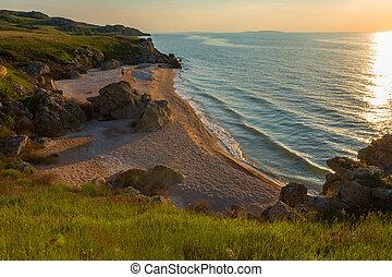 Sunset over the Sea of Azov on Generals beach. Karalar...